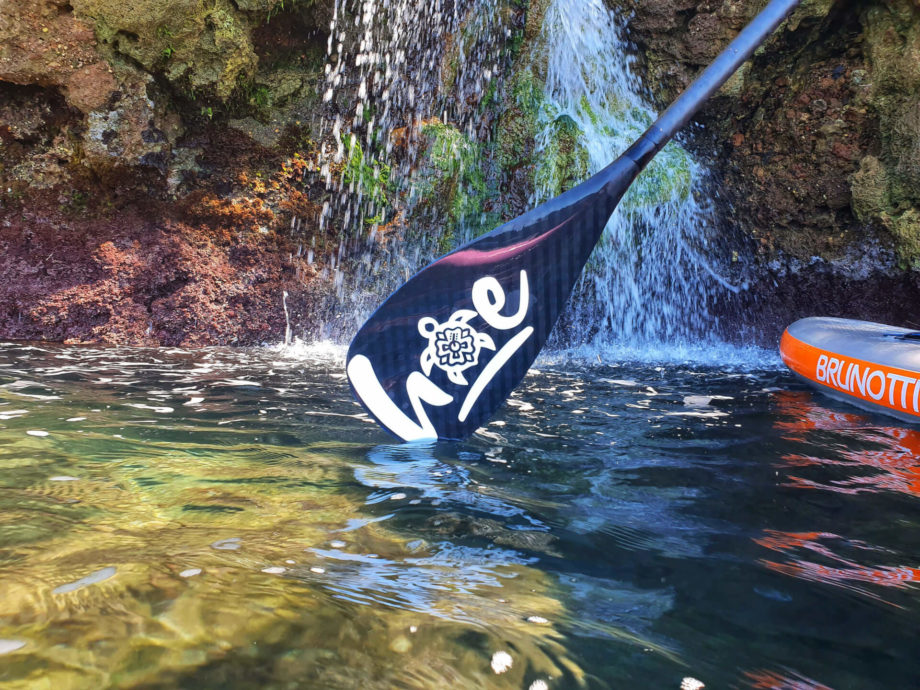 hoecustompaddle model carey surf in water waterfall